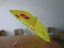 yellow golf umbrella