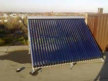 split heat pipe solar collector for harmony with the building