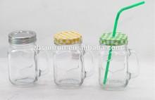 Glass mason jar with handle and metal lid