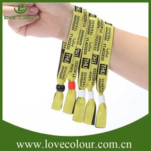 Fashion attractive custom plastic clip woven wristband for festival