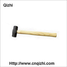 black smith's hammer with white bleached wooden handle
