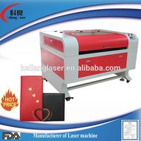 Keliang 690 co2 laser cutting machine motorized rotary table