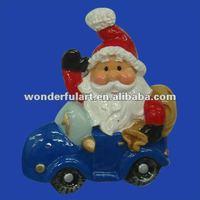 decorative ceramic santa claus sitting on car