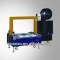 Yk-55arl baja- nivel& flejes de máquina de embalaje para el uso en la línea de embalaje