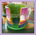 Family enjoy coffee cup outdoor amusement park rides