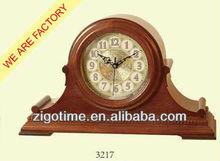Big size wooden antique desk clock at office