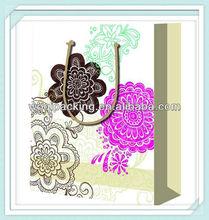 Paper bag with157gsm art paper & ribbon handle & flower design