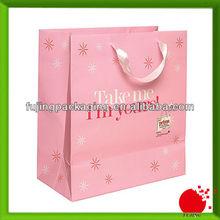 Pink gift shopping bag with ribbon handle