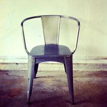 Photos of Vingage old metal marais coffe shop armchairs