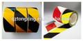 reflectante de color negro y amarillo cinta de precaución