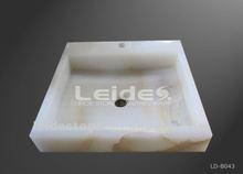 White onyx vessel sink