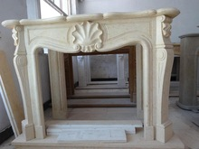 Delicate yellow marble fireplace mantel
