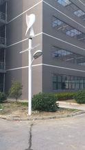 Wind solar hybrid street lighting/wind turbine