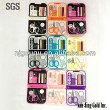 snap,pin,pilot pin,thread,button,tweezers,threader,needle,cissors sewing kit yellow & white plastic box
