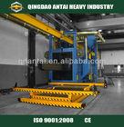 Overhead conveyor shot blast clean-up machine