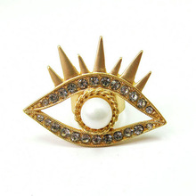 The symbol of power unique crystal and pearl eye rings