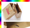 recycled brown paper bag with red handle
