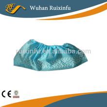Nonwoven slip resistant shoe cover