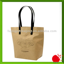 Personalized brown paper bags with leather bags