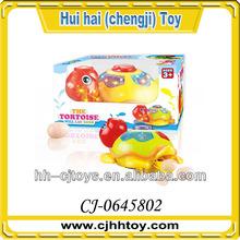 2014 top selling musical flashing cartoon animal toys that lay eggs