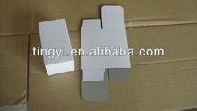 small white cardboard paper box