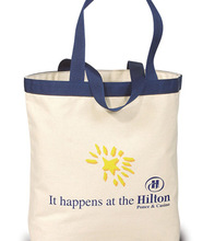 """Made in the USA cotton canvas tote bag. Comes with 24"""" colored poly-web handles and your logo."""