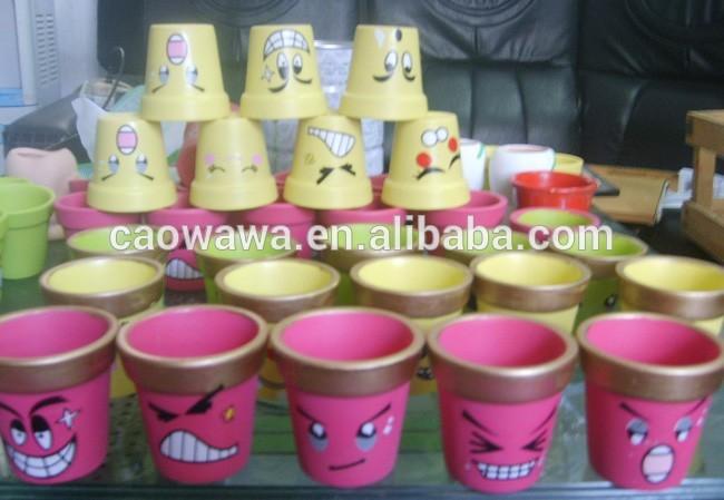 Mini pots en terre cuite gros avec le visage de dessin anim expression design pots fleurs - Terras versieren ...