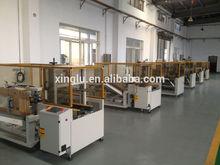KX-01L high speed adhesive tape carton erector and bottom sealer