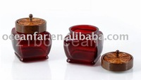 Color sprayed candle jar with wood cap