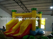 Inflatable moonwalk with slide