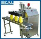 Plastic bottle cap sealing machine