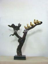 bird in tree resin sculpture