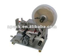 Semi automatic plain labeling machine