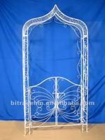 decorative metal garden arch with door