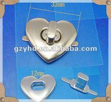 2012 new design handbag metal heart shape turn lock