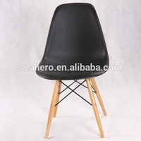 Molded Plastic Side Chair Wooden Dowel Base lounge chair with ottoman replica