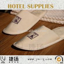 milk white so comfortable embroidery logo massage slipper and cheap hotel slipper