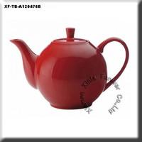 red glazed ceramic coffee pot