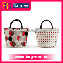 Hot sale professional fashion famous ladies handbags with flower on front of handbag