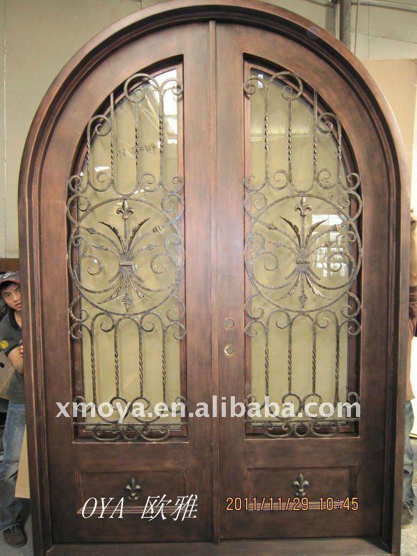 Decorative wrought iron door grill