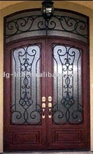 wrought iron and forged double doors with transom design