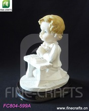 Resin kneeling position boy religious sculpture