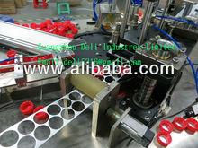 cap seals inserting machine