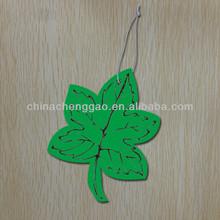 green leaf shaped decorative car freshener perfume