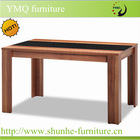 Black glass and paper covered high quality wood dining table