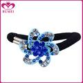 Venta al por mayor chica flor azul accesorios cabello cristal