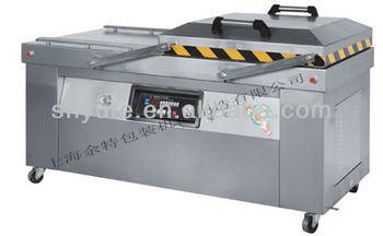 Automatic clamshell vacuum machine