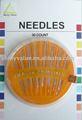 agulha de costura com laranja caixa de cor