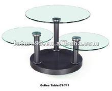 Modern round swivel glass coffee table