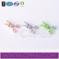 Scissors type of rivet for children clothing
